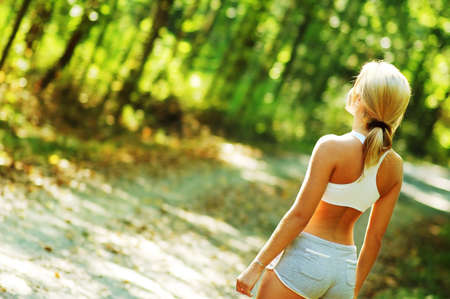 babe: Pretty young girl runner in the forest.
