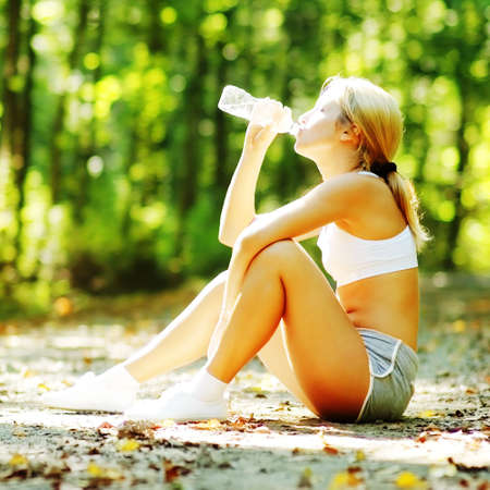sports bra: Pretty young girl runner in the forest.