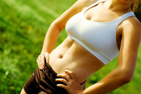 tummy: Close up view of beautiful womans abdomial muscles.