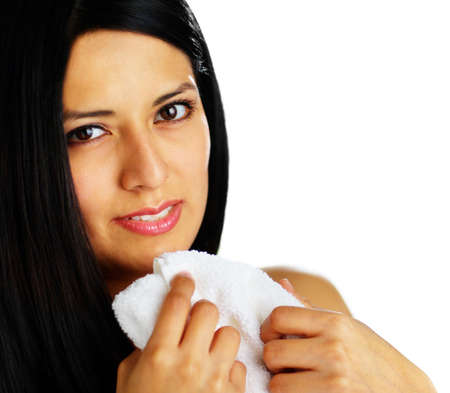 Close up of a spa woman hugging a white towel.