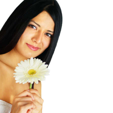 Beautiful young spa woman holding a flower against white. photo