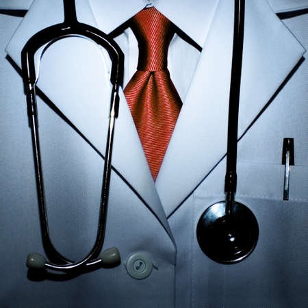 medical profession: Conceptual photo of a scarry doctor with blood red tie.