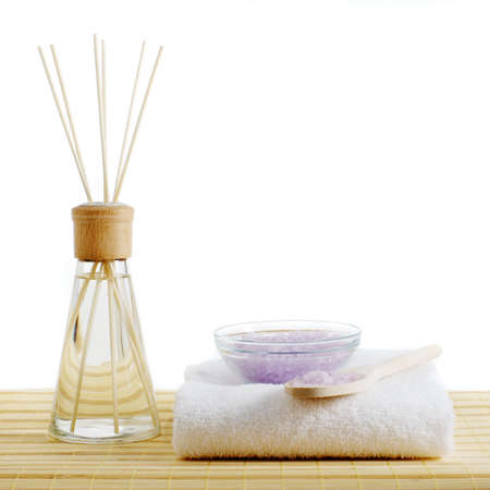 Spa scene on top of a bamboo mat and against a white background. photo