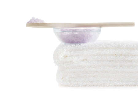 Towels and bath salt being displayed against a white background. photo