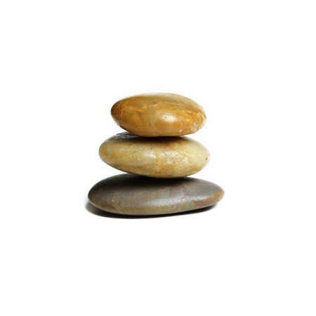 Stack of stones against a white background. photo
