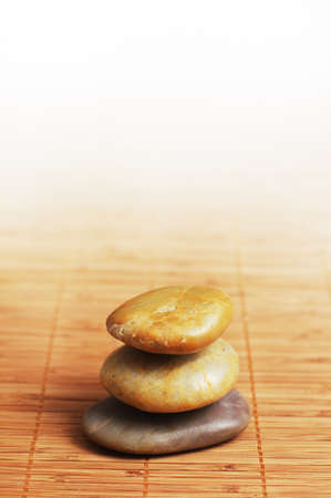 Stack of rocks on top of a bamboo mat. photo