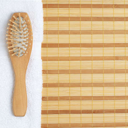revitalize: Brightly lit spa display on top of a bamboo mat.