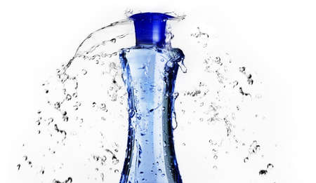 Blue shampoo bottle with water splashing around it. 스톡 콘텐츠