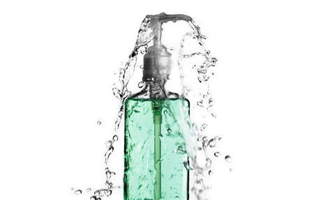 Green bottle splashing water against a white background.