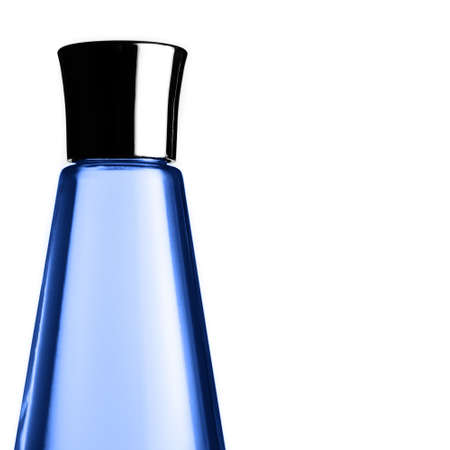 Blue, shiny, modern bottle against a white background. 版權商用圖片