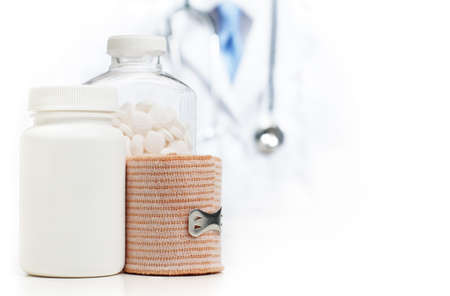 Doctor with medical supplies against a white background.