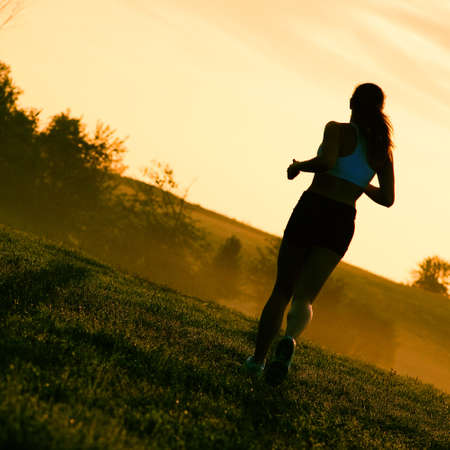 Beautiful young woman runner having a workout session. Stock Photo