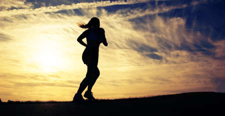 Beautiful young woman runner having a workout session. Stock Photo - 4512189