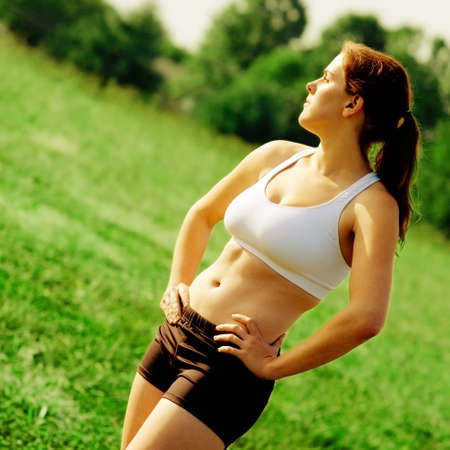 tummy: Beautiful young woman runner having a workout session. Stock Photo