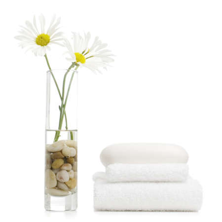 towels bath: Spa display against a bright white background.