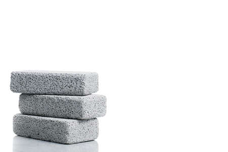A stack of pumice stones against a white background.