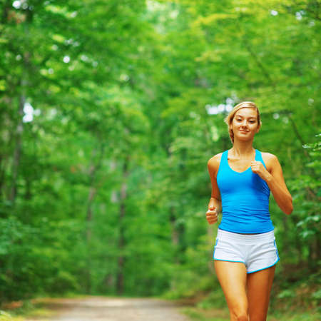 Woman runner exercising, from a complete series of photos. Stock Photo