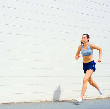 woman running: Mature woman working out in an urban setting, from a complete set of photos.