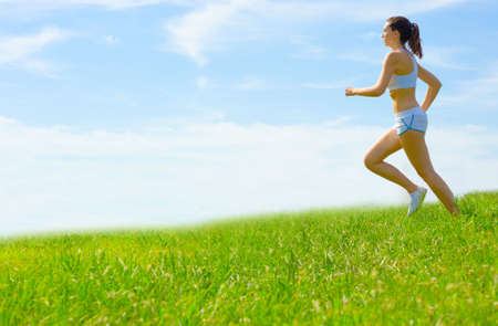 Mature woman athlete practicing in a spring meadow, from a complete series. photo