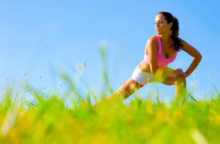 Athletic woman working out in a meadow, from a complete\ series of photos.