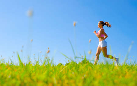 Athletic woman working out in a meadow, from a complete series of photos. photo
