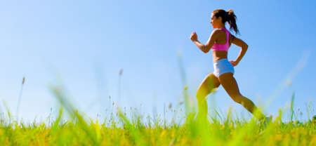 outdoor fitness: Athletic woman working out in a meadow, from a complete series of photos.