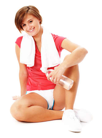 Young woman resting after excercise, from a complete series of photos. Stock Photo - 5640616
