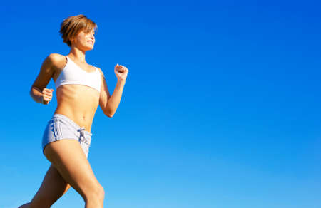 Fit young woman working out, from a complete series of photos. Stock Photo
