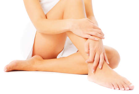 Close up of legs being massaged isolated on white, from a complete series of photos. Stock Photo - 5640551