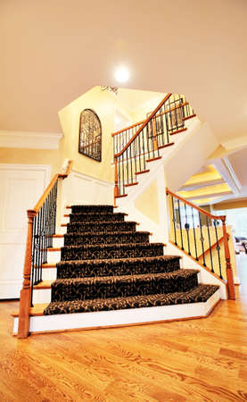 Low angle view of staircase and entryway in an upscale home. Vertical format. photo
