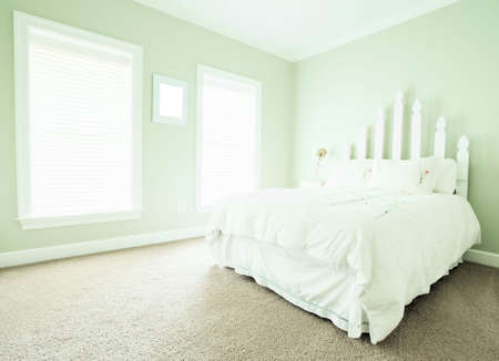 View of a simple upscale bedroom, decorated in light neutral shades. Horizontal format. Stock Photo - 6248877