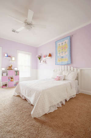 interior spaces: Wide angle view of a girls bedroom. Vertical format.