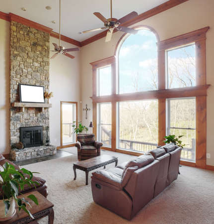 living room interior: Traditional living room interior with a high ceiling and large windows. Square format.