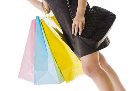 Closeup of Chinese womans midsection. She's holding a purse and shopping bags. Stock Photo - 11261434