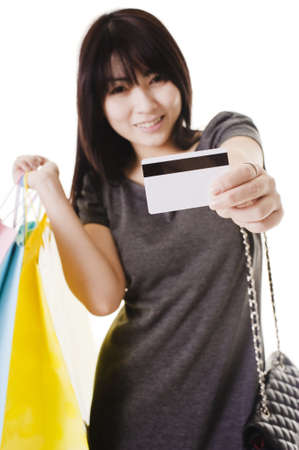 Beautiful Chinese woman holding up a credit card. photo