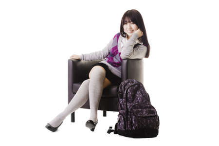 Portrait of a stylish Chinese school girl sitting in a leather chair. Stock Photo - 11261415