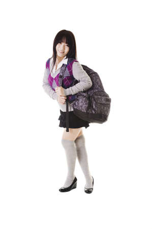 long socks: Female Chinese student with a backpack on a white background.