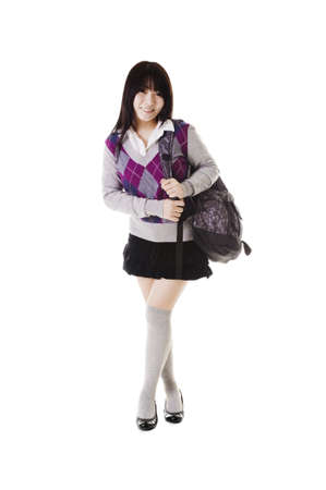 east asian ethnicity: Female Chinese student with a backpack on a white background.