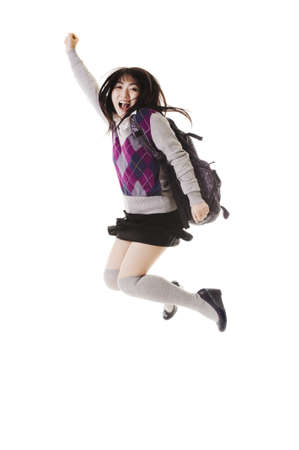 long socks: Female Chinese student with a backpack on a white background jumping in the air. Stock Photo