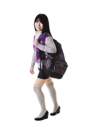Female Chinese student with a backpack on a white background.