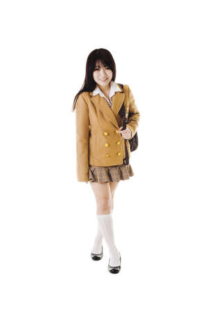Female Chinese student wearing a backpack on a white background. photo