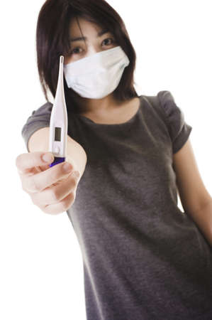 Closeup of a sick Chinese woman wearing a face mask holding a digital thermometer. Stock Photo - 11261437