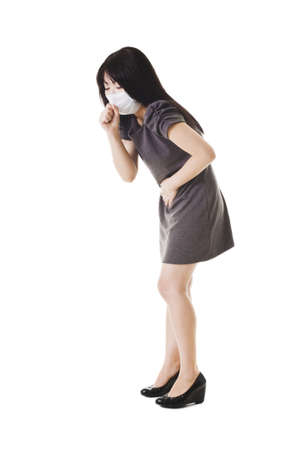 Sick Chinese woman wearing a face mask holds her stomach and coughs. Stock Photo - 11261360