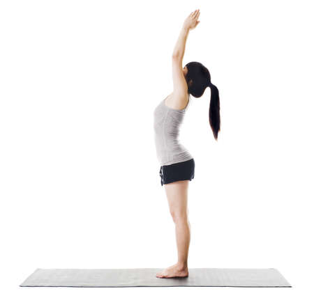 side pose: Chinese woman on a yoga mat doing the upward salute pose.