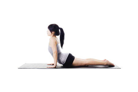Chinese woman on a yoga mat doing the upward facing dog pose. photo
