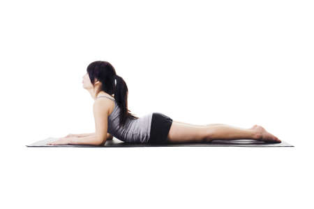 side angle pose: Chinese woman on a yoga mat doing the sphinx pose.