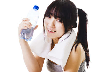 Portrait of a Chinese woman holding a water bottle after a workout. photo