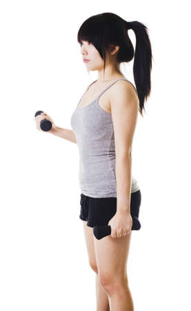 Chinese woman doing bicep curls with small hand weights. photo