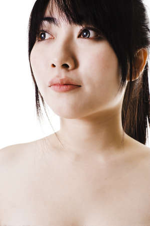 headshoot: Closeup of a beautiful Chinese woman with smooth, clear skin, looking off into the distance.