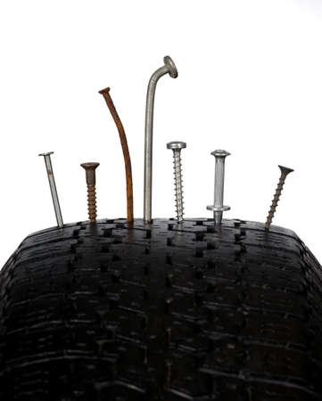 grey nails: wheel with nail Stock Photo